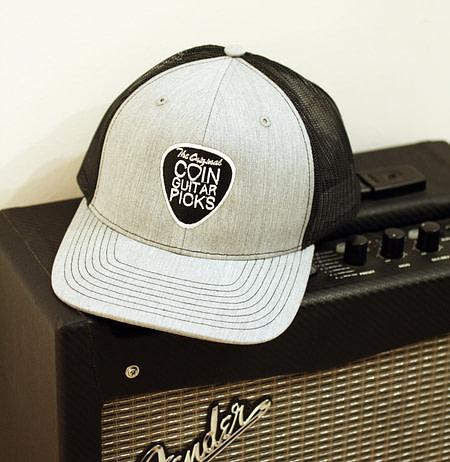 The Original Coin Guitar Picks Hat on amp
